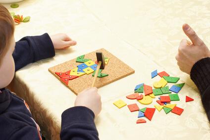 Ergotherapie Pädiatrie Kind mit Spiel